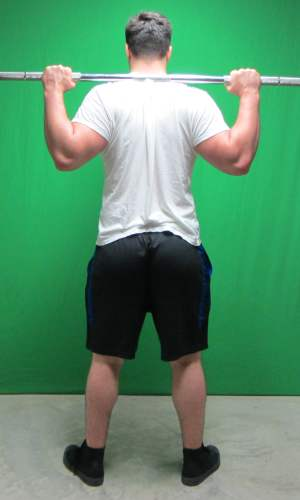 high bar squat position standing rear view