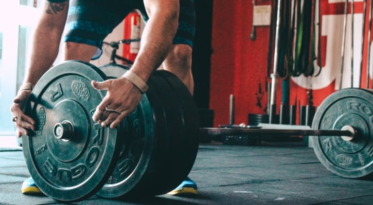 Adding Weight to the Bar to Achieve Progressive Overload