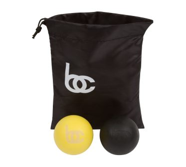 black and yellow lacrosse balls with bag