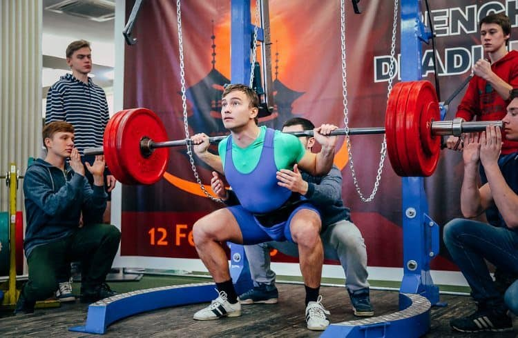 Man Squatting in a Monolift at a Powerlifting Competition
