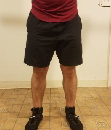 Squatting in A7 Center-stretch Shorts - Front View - Top of Squat Rep