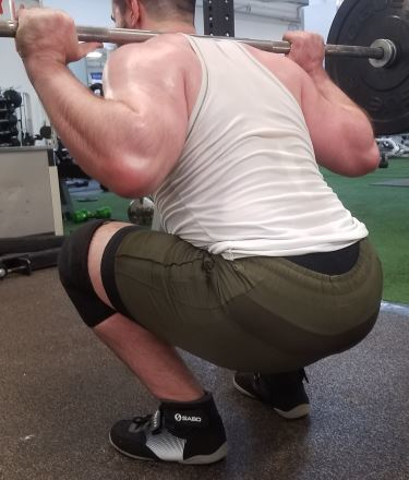 Squatting in Young LA Lifting Shorts - Rear Angled View