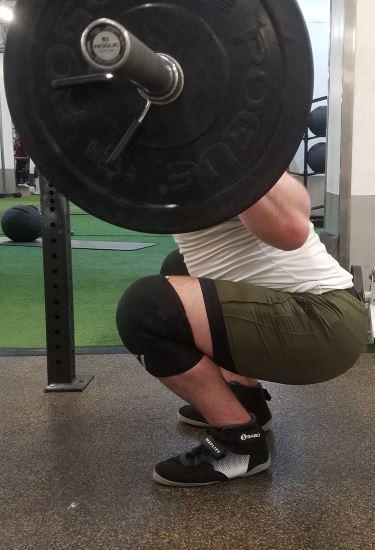 Squatting in Young LA Lifting Shorts - Side View - Bottom of Squat