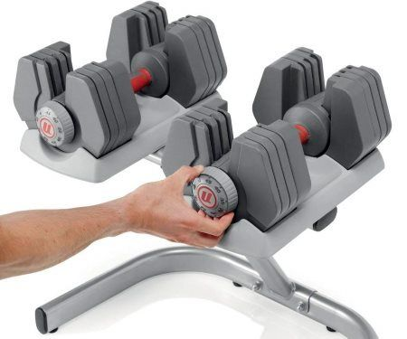 Universal 445 Selectorized Adjustable Dumbbell Set - Man Adjusting Weight Dial