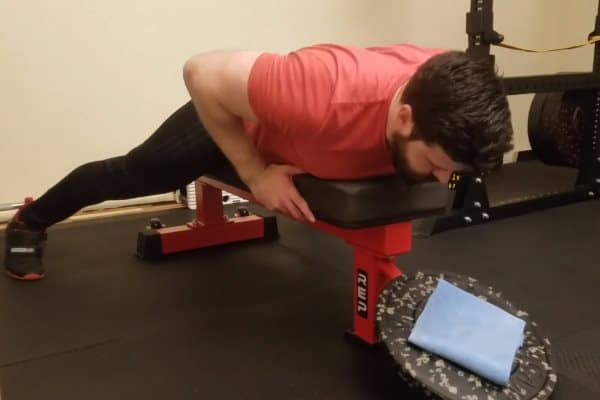 Weighted Lying Neck Extension Setup - Straddle Bench Then Adjust Stance & Torso Position