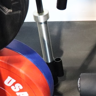Force USA G20 - Closeup of Olympic and Standard Barbell Storage Sleeves on Lat Row Station